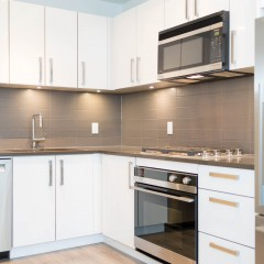 Modern kitchens at Wallace & McDowell with stainless steel appliances and gas range.